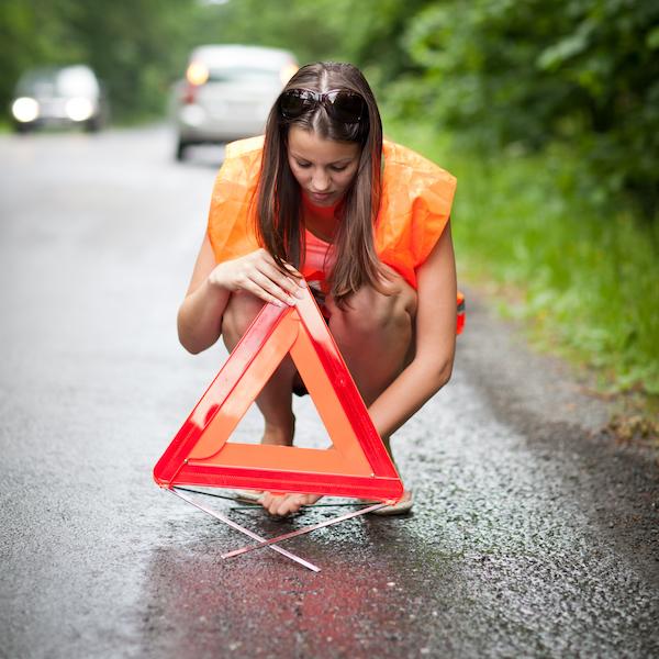 woman on a road. broken car.