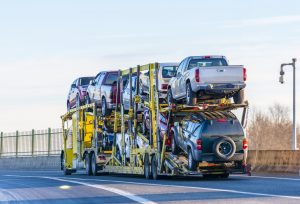 yellow-big-rig-car-hauler-with-several-cars-loaded