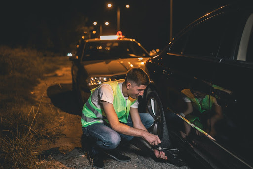 roadside assistance helping fix a tire